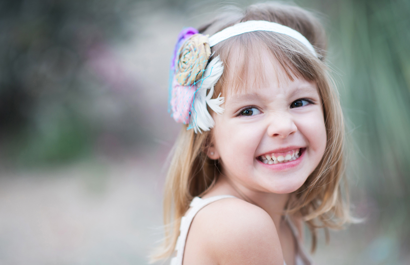 close up, laughing, cute headbands, little girl portraits, outdoor photography, meagan baker photography