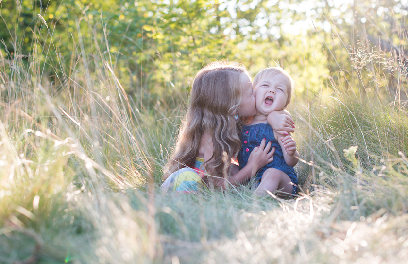 kisses, sibling love, outdoor photography, candid photography, meagan baker photography